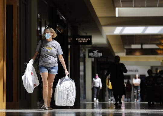 Julie Peerenboom of Little Chute is ready to return purchased items Wednesday at the Fox River Mall in Grand Chute.