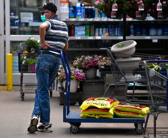 Bill Harner waits in line at the south Abilene Lowe's Home Improvement store April 21. Gardeners have begun flocking to local nurseries and garden centers for their annual needs despite the threat of coronavirus.