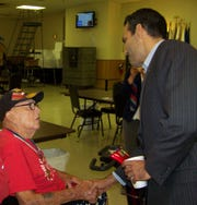 Land Commissioner George P. Bush (right) meets Army retiree Johnny Dutton during a 2015 visit at VFW Post 6873. Dutton served in 1945-46, assisting in Germany after the end of World War II.