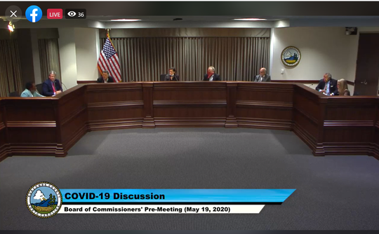 A Buncombe County Board of Commissioners pre-meeting streams on Facebook May 19, 2020.