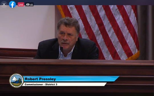 Commissioner Robert Pressley speaks at a board meeting May 19, 2020.