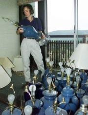 Leslie Davis of Duxbury looks at one of many $3 lamps at a yard sale at Bolton Valley Resort on July 24, 1999.