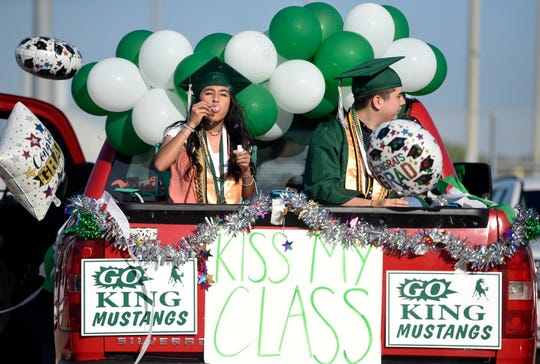 King High Schools hosts a parade for their seniors, Monday, May 18, 2020. The graduates decorated their cars and wore their cap and gowns while social distancing.