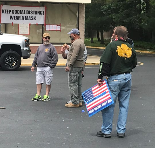 Supporters of The Atilis Gym stand in the parking lot of the Browning Road business on Wednesday.