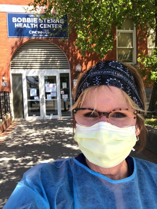Deann Ramey sporting her mask while working in downtown CIncinnati.