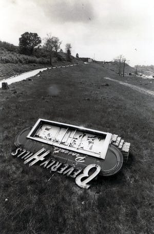 """Photo from """"Cincinnati: An Illustrated Timeline"""": The fallen sign of the Beverly Hills Supper Club marks the tragedy where 165 people lost their lives in 1977. (The Cincinnati Enquirer/Ed Reinke)"""