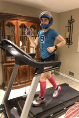 Rachel Belmont during her 100-mile run on a treadmill to raise money for PPE