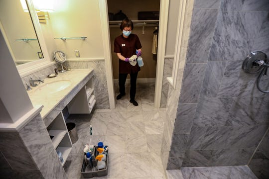 Yan Mei, a room attendant at Royal Park Hotel cleans a room at the hotel in Rochester, Mich. Photographed on May 19, 2020, the hotel reopened its doors to guests on May 18 after closing for two months.