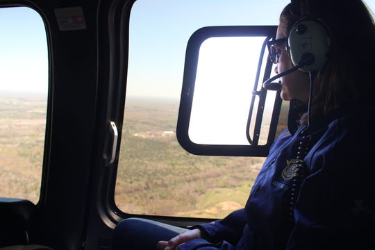 Governor Gretchen Whitmer surveys the area from a helicopter after flooding and a dam breach in Midland County on Wednesday, May 20, 2020.