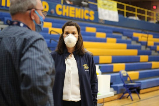 Governor Gretchen Whitmer surveys the shelter area set up at Midland High School after flooding and a dam breach in Midland County on Wednesday, May 20, 2020.