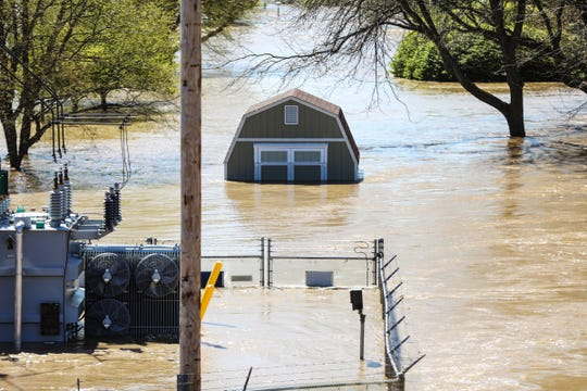 Downtown Midland, Mich. is under 9-10 feet of flood water from Tittabawasse river after the Edenville and Sanford dams failed flooding the area, photographed on Wednesday, May 20, 2020.