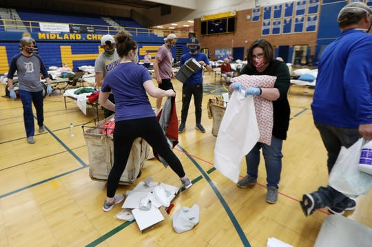 Community volunteers gather donations and make beds for incoming residents that have been evacuated from their homes in Midland, Mich. after Edenville and Sanford dams failed flooding the area, photographed on Wednesday, May 20, 2020.
