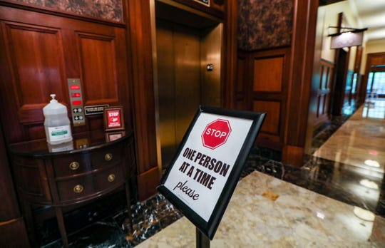Only one guest at a time may enter the elevator at Royal Park Hotel, which has made changes in response to the coronavirus after closing for two months in Rochester, Mich. Photographed on May 19, 2020, the Royal Park Hotel reopened to guests on May 18.