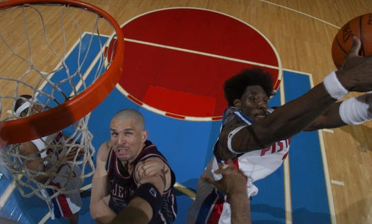 Pistons' Ben Wallace pulls down a rebound against New Jersey Nets' Jason Kidd during the second half of Game 7 of the Eastern Conference semifinals Thursday, May 20, 2004 at the Palace of Auburn Hills.