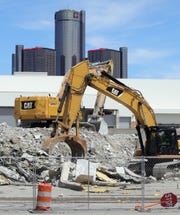 Construction crews take down some of the final parts of the Red Wings home Joe Louis Arena Wednesday, May 20, 2020.