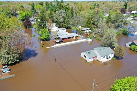 Homes around North Saginaw Road in Midland are surrounded by floodwater, Wednesday.