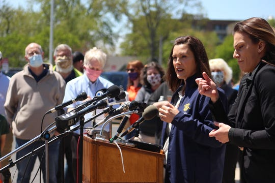 Gov. Gretchen Whitmer speaks at a press conference in Midland on May 20, 2020. She declared a state of emergency for Midland County after the Edenville and Sanford dams breached.