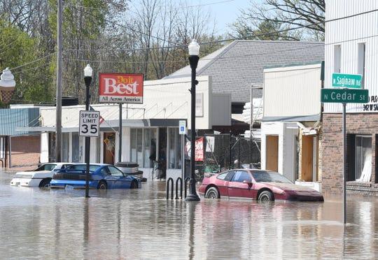 Sanford's main street, W. Saginaw Street is flooded.