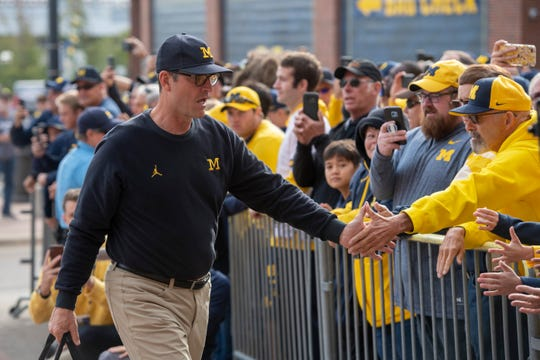 Michigan head coach Jim Harbaugh says he'd be OK with playing college football games in empty stadiums.