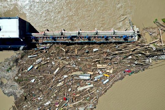 Debris backs up along the Sanford Dam near the Village of Sanford.