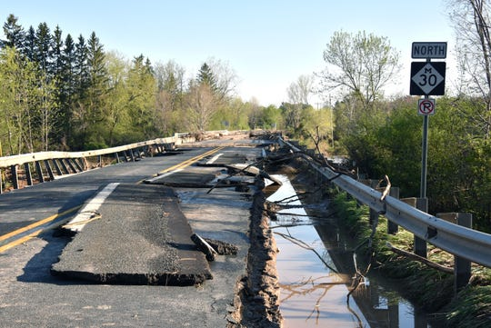 The roadway on the Edenville Bridge on M-30 was severely damaged by the flooding caused by the collapse of the Edenville dam.