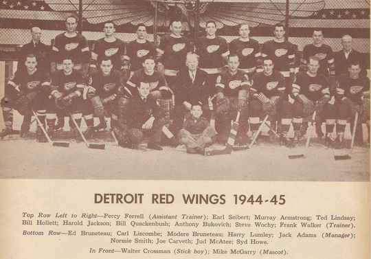 The 1944-45 Detroit Red Wings, top row, from left: Percy Ferrell, Earl Seibert, Murray Armstrong, Ted Lindsay, Bill Hollett, Harold Jackson, Bill Quackenbush, Anthony Bukovich, Steve Wochy, Frank Walker; bottom row, from left: Ed Bruneteau, Carl Liscombe, Modere Bruneteau, Harry Lumley, Jack Adams, Normie Smith, Joe Carveth, Jud McAtee, Syd Howe; in front, from left: Walter Crossman, Mike McGarry. (Courtesy of Greg Innis)