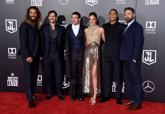 """The cast of """"Justice League,"""" from left, Jason Momoa, Henry Cavill, Ezra Miller, Gal Gadot, Ray Fisher and Ben Affleck, pose at the premiere of the film in Los Angeles. Warner Bros. Pictures say that director Zack Snyder's cut of the film will debut next year on the streaming service HBO Max."""