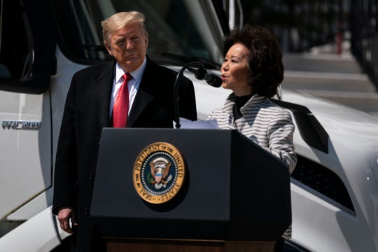President Donald Trump listens as Secretary of Transportation Elaine Chao speaks during an event celebrating American truckers, at the White House, Thursday, April 16, 2020, in Washington.