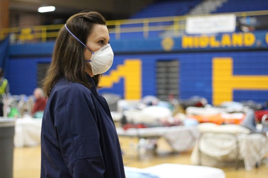 Michigan Governor Gretchen Whitmer visits an emergency shelter for flood evacuees at Midland High School Wednesday.