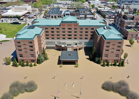 The H Hotel has water up to its doors in downtown Midland, May 20, 2020.