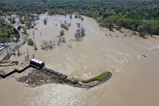 This drone photo shows the Sanford Dam, the right side of which has been breached by floodwaters.