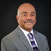 Dr. Herman Gray