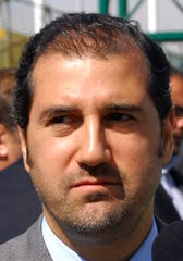 FILE - In this April 24, 2010, file photo, Rami Makhlouf, a cousin of Syrian President Bashar Assad and one of that country's wealthiest businessmen, attends an event to inaugurate a hotel project in Damascus, Syria.