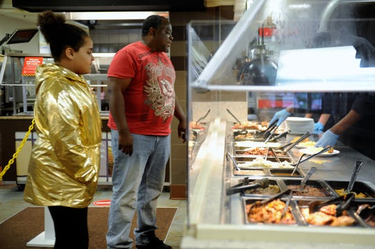 The steam tables at the Evansville Golden Corral are staying spotless as employees serve customers and keep them wiped down. Alanzo and Allyah Woods enjoy the new service on Monday, May 18. 2020.