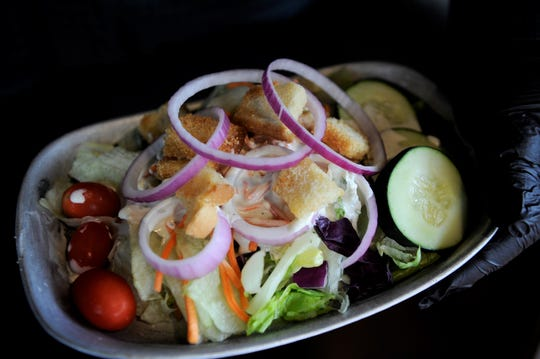 """The Cork """"N Cleaver in Evansville took a week to serve composed Caesar and house garden salads with entrees before reopening the salad bar with an attendant to fill diners' plates."""