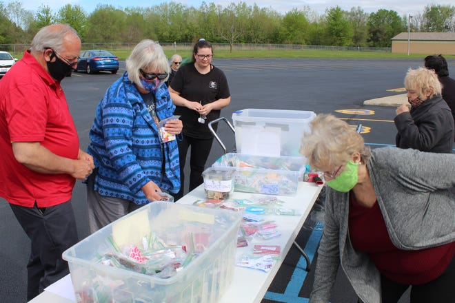 Visitors looked for free cloth masks Wednesday at the Clyde VFW Post 3343 parking lot. The masks were made by members of the Ladies Auxiliary and free of charge in exchange for a nonperishable food donation. Those food donations will be taken to the Clyde Food Pantry.