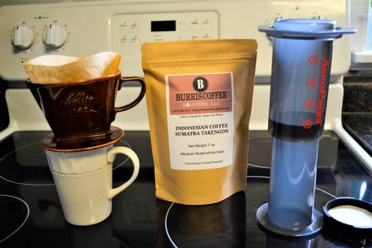 Although Daniel Burris recommends brewing his coffee with the pour over method, shown on the left, or with an AeroPress, on the right, it can be brewed with any method.