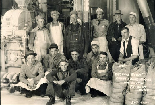 Workers stop for a photograph inside the Great Lakes Sugar plant in Fremont in 1940.