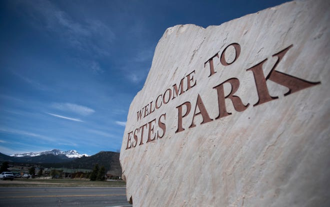 A sign welcomes visitors to Estes Park, Colo. on Monday, May 18, 2020.