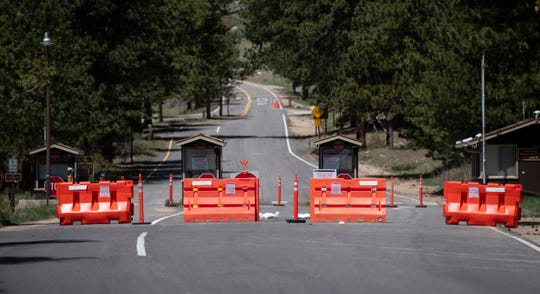Barricades block one of the entrances to Rocky Mountain National Park near Estes Park, Colo. on Monday, May 18, 2020. The national park closed in March due to state and local public health recommendations related to the coronavirus pandemic.