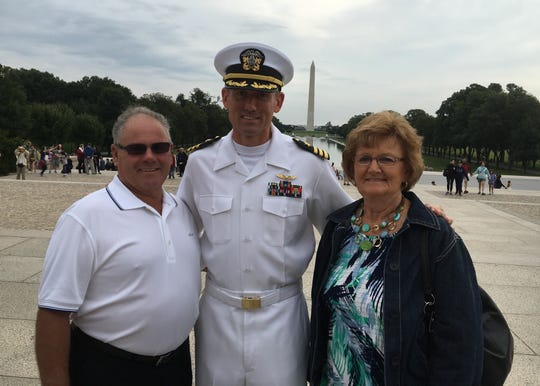 U.S. Navy Cmdr. Jamie Delcore, a native of New Franken and 1991 graduate of Luxemburg-Casco High School, is joined by his parents, Ken and Pat Delcore, on the National Mall in Washington, D.C.