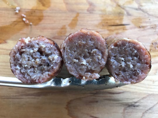 Coarseness of the meat grind impacts a bratwurst's flavor. Coarser grinds provide more pop at first bite while finer grinds release more flavors as the meat is chewed.