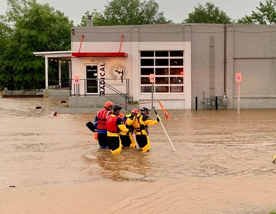 Greenville firefighters conduct a swift water rescue Wednesday, May 20, 2020 on Willard Street.