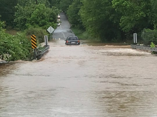 A car sits stranded in flood water on Brooks Avenue in Greenville County Wednesday, May 20, 2020.