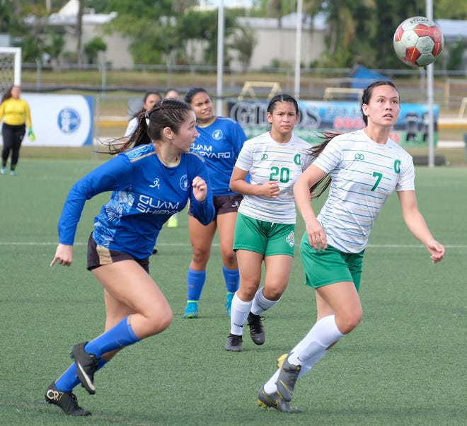 Colleen Naden, right, gains control of the ball during a match against Guam Women's Shipyard on Feb. 16. As the leading scorer in the league, Naden was named the University of Guam's Student Athlete of the Year as well as the MVP for the women's soccer team.