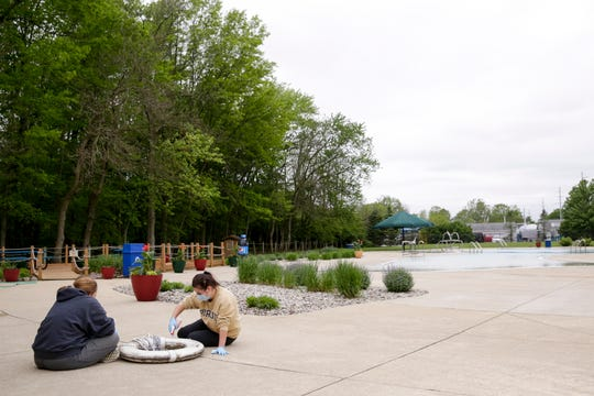 Becky Hutzel, left, and Jennie Flahaut clean a lifesaver at Castaway Bay in Armstrong Park, Wednesday, May 20, 2020 in Lafayette.