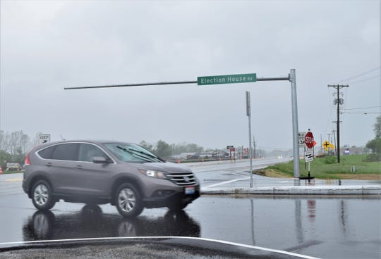 A driver passes through the intersection at Election House Road and Columbus-Lancaster Road, which has recently undergone changes to improve safety. The project should be completed in June, when the traffic signals are installed.