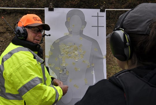 Ken Temple, left talks to a student at the Hocking College shooting range. Temple is retiring as the Natural Resources Law Enforcement program manager at Hocking College at the end of May. Temple worked full time at the college for 14 year after spending 30 years working for the Ohio Department of Natural Resources.