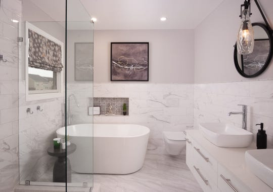 The master bath features white and gray Carerra marble in this Buechel home.