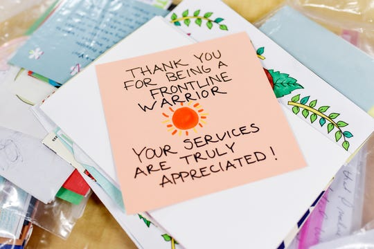 Cards for for employees working in labs, as nursing assistants, respiratory therapists and housekeeping were collected to put into 800 care packages on Wednesday, May 20, 2020, at McLaren Greater Lansing hospital in Lansing.